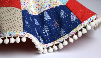 _naughty-or-nice-fabric_tree-skirt-tied_detail-2